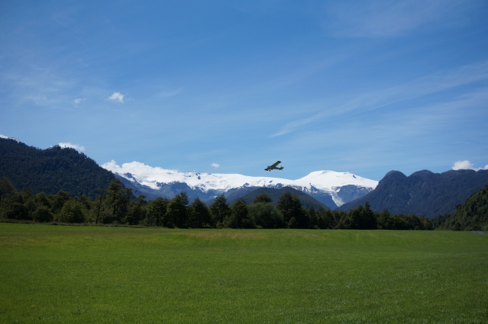 Me laughing in a field & Douglas Tompkins flying away over the mountains (I later confirmed at his farm that yes, it certainly was Douglas in the plane).
