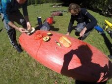 A kayakers make lunch.